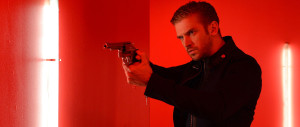 The Guest - Dan Stevens, red background