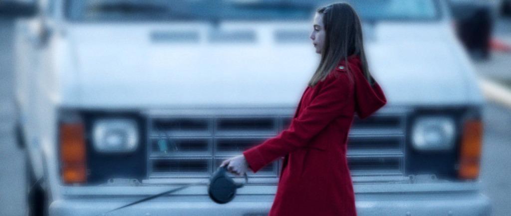 A Walk Among the Tombstones - red coat girl and van