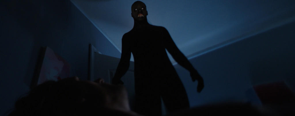 The-Nightmare---shadow-man-standing-over-woman